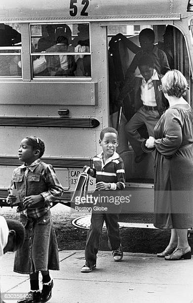 Students arrive by school bus at the Eliot School in Boston's North End on Sept 5 1979 An initiative to desegregate Boston Public Schools was...