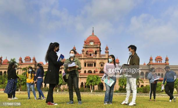 Students arrive to attend classes at Khalsa College after the state government allowed reopening of colleges and universities that were closed due to...