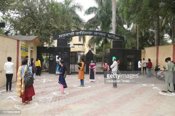 Students arrive to attend classes at the Government Rajindra College campus after the state government decided to re-open universities and colleges...