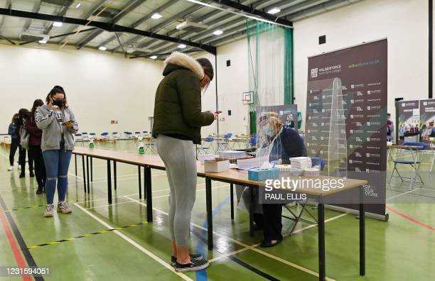 Students arrive to take a Covid-19 Lateral flow test in the sports hall of Wilberforce college in Hull, northeast England on March 8, 2021 as schools...