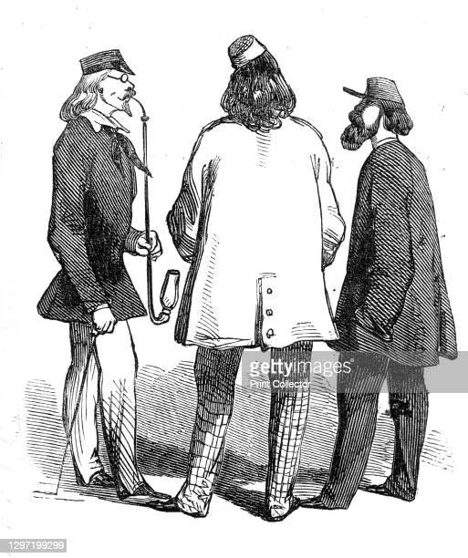 Students at Bonn, 1845. Young men at Bonn in Germany: '...the small cap, jauntily placed upon a pile of hair, the short quaintly cut morning coat,...