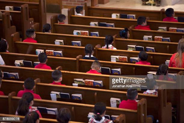 students at catholic school. - catholicism stock pictures, royalty-free photos & images