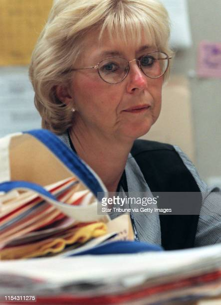 Students at Champlin Park High School work on a Profile of Learning project Social Studies teacher Nancy Stafford with a stack of paperwork that she...