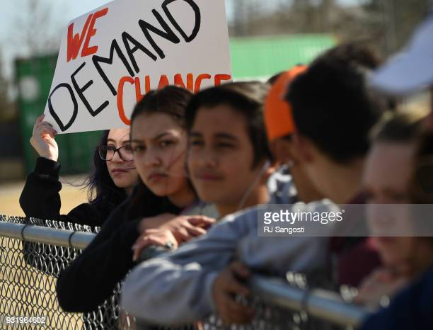 Students at Columbine High School walk out of classes in protest of gun violence for 17 minutes one minute for each Florida high school shooting...