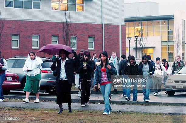 Students at Foss High School evacuate the building after an early morning shooting leaving one student dead Wednesday January 3 in Tacoma Washington