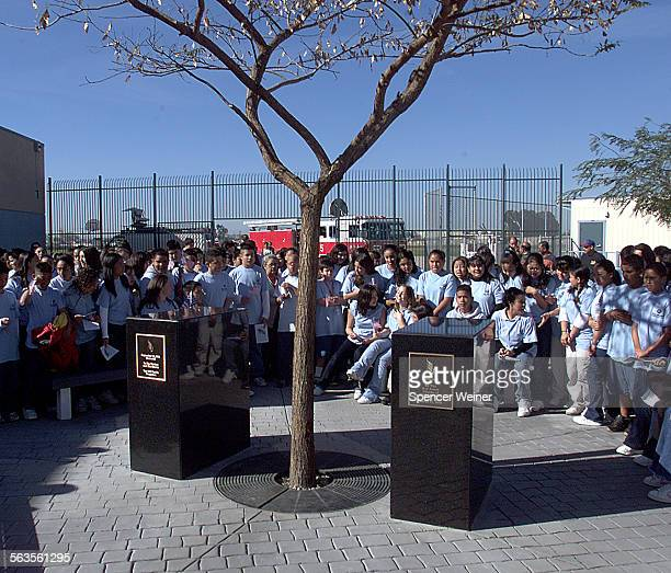 Students at Frank Intermediate School in Oxnard gather around a memorial to those killed on Sept 11 particularly those on American Airlines Flight 77...