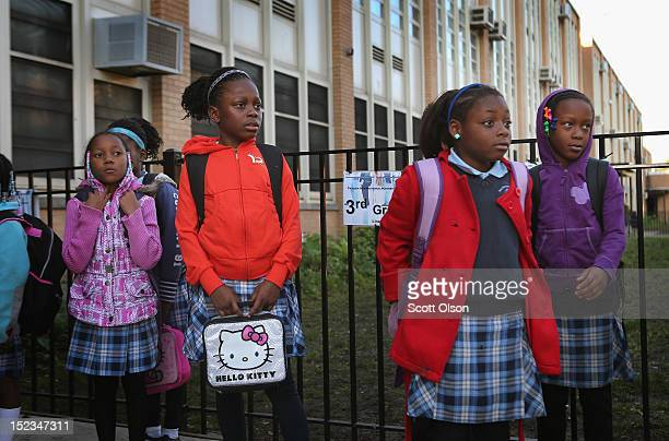 Students at Frazier International Magnet School wait outside before the start of school on September 19 2012 in Chicago Illinois Today was the first...
