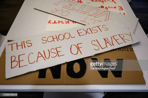 Students at Georgetown University mades signs and protested for the school to make amends for its history, with reparations funded by student fees to...