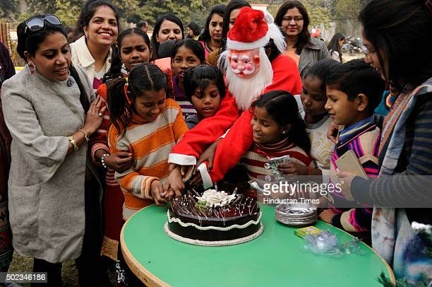Students at Institute Of Management Studies celebrate Christmas with underprivileged children on the eve of Christmas on December 23, 2015 in Noida,...