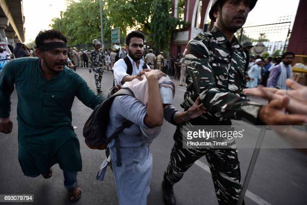Students at Jamia Milia Islamia University during a protest against the Iftar party organised by RSS Muslim faction Rashtriya Muslim Manch on June 5...