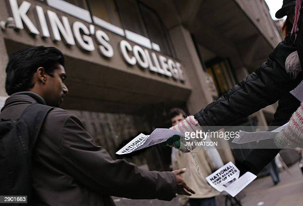 Students at King's College in Central London hand out fliers 26 January 2004 calling for a demonstration against topup fees to be held 27 January...