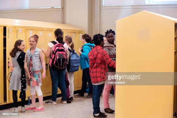 students at locker happy because it is school's out - state school stock pictures, royalty-free photos & images