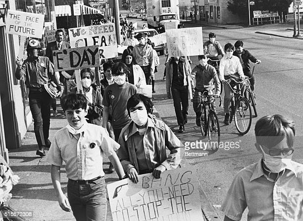 Students at Nipher Junior High School marching through the business district of suburban Kirkwood 4/22 protesting against smog caused by automobiles...