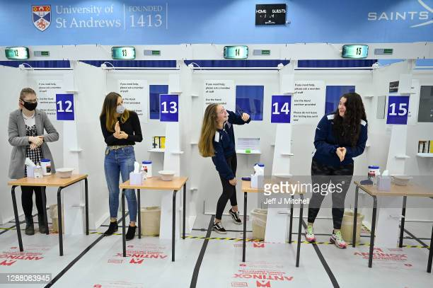 Students at St Andrew University participate in testing of lateral flow antigen test facility before opening at the weekend on November 27 2020 in St...