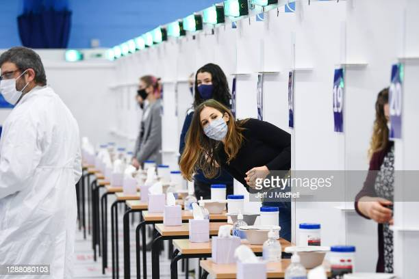 Students at St Andrew University participate in the testing of a lateral flow antigen test facility before its opening at the weekend on November 27...