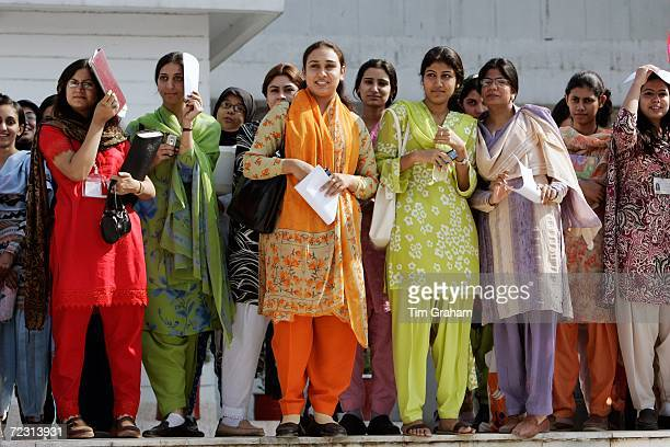 Students at the all female Fatima Jinnah University await the arrival of Prince Charles and the Duchess of Cornwall on October 31 2006 in Rawalpindi...