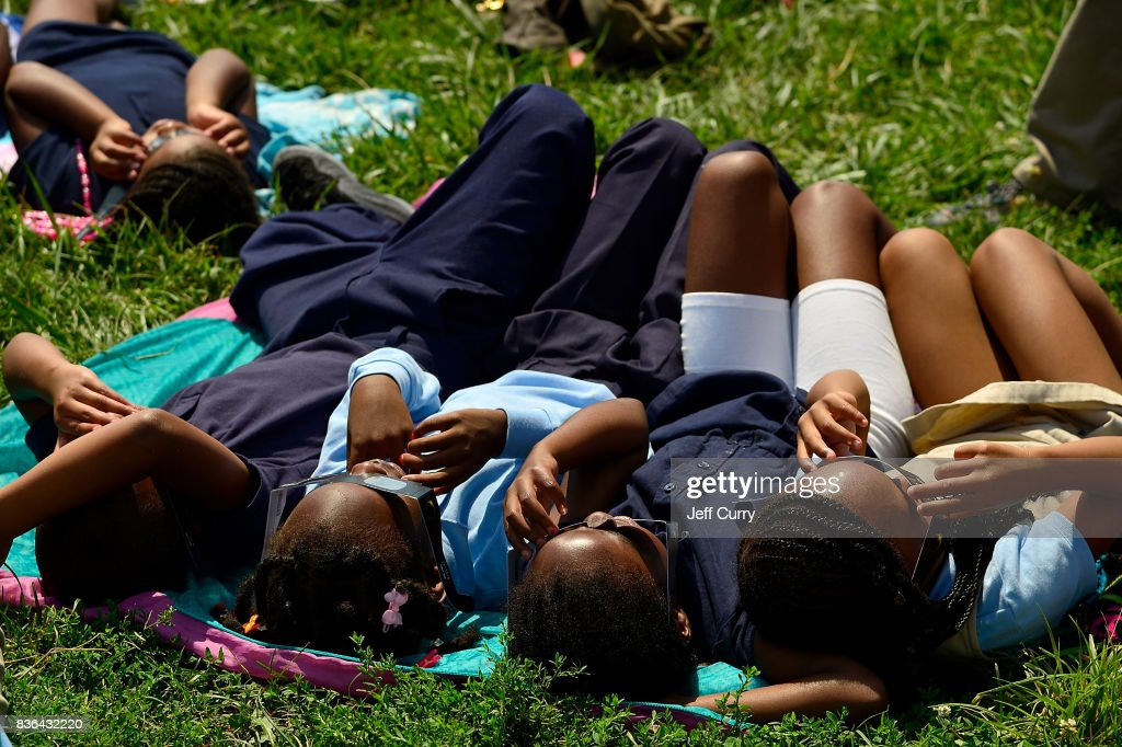 Students at the Jennings School District view the solar eclipse with glasses donated by Mastercard on August 21, 2017 in St Louis, Missouri.
