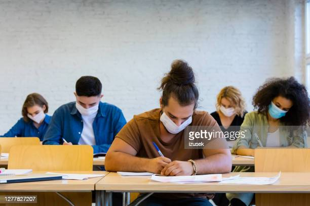 students at the lecture during coronavirus pandemic - school building stock pictures, royalty-free photos & images