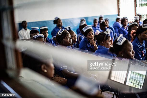 Students at the Midwifery School wait in a classroom before classes start on April 26 2017 in Masuba central Sierra Leone In the wake of the Ebola...