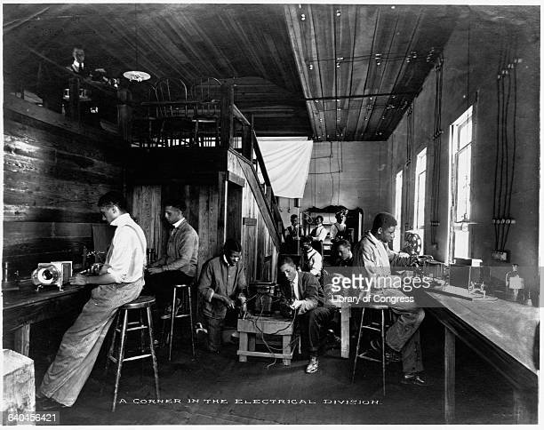 Students at the Tuskegee Institute founded by Booker T Washington work with electrical machines in the Institute's electrical division 19131914