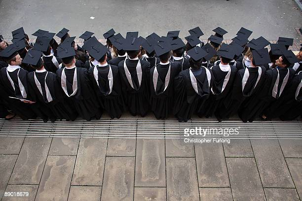 Students at the University of Birmingham pose for a group photograph as they take part in their degree congregations on July 14 2009 in Birmingham...