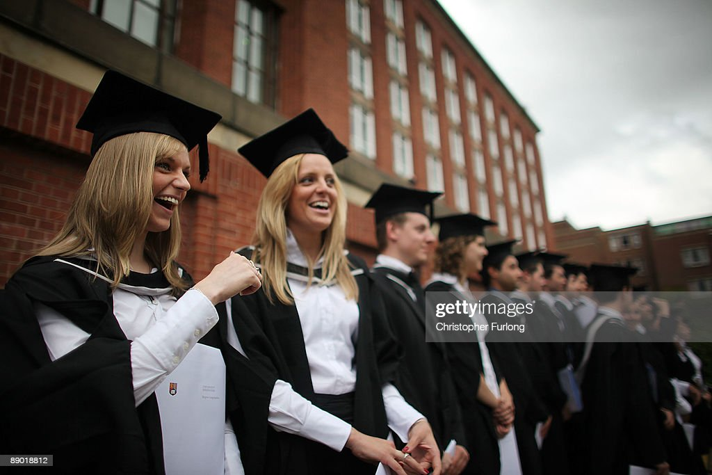 Students at the University of Birmingham pose for a group photograph as they take part in their degree congregations on July 14, 2009 in Birmingham, England. Over 5000 graduates will be donning their robes this week to collect their degrees from The University of Birmingham. A recent survey suggested that there are 48 graduates competing for every job.