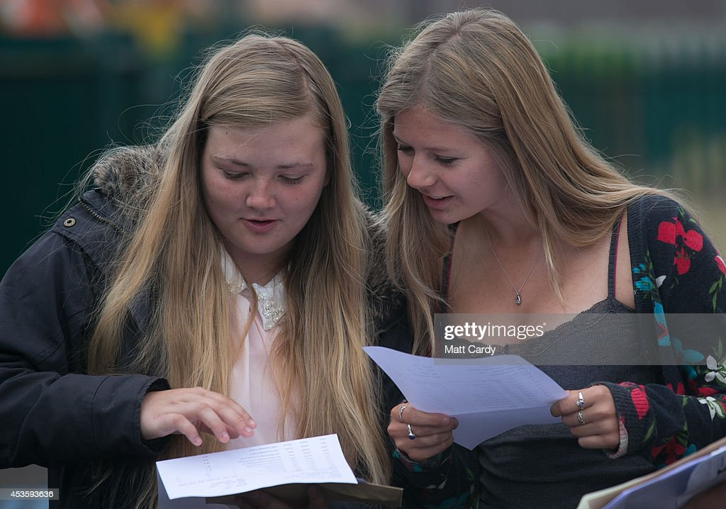 Students at the Winterbourne International Academy react as they open their A-level results on August 14, 2014 in South Gloucestershire, near Bristol, England. Across England, Wales and Northern Ireland students were receiving their A-level results this morning and for the first time in over 30 years there has been a slight fall in the pass rate. However, there is now a record number of university places available and some students may still get their places even if they did not get the grades.