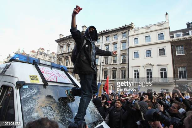 Students attack a police van in Whitehall during a demonstration over tuition fees and university funding on November 24 2010 in London United...