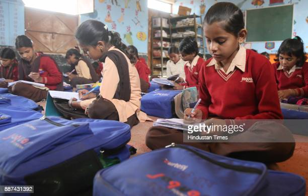 Students attend a class at Shaheed Balwant Singh Government Model Senior Secondary School in Ujholi Kot Kasim District Alwar on November 30 2017 in...