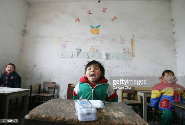 Students attend a class at Xinxing School a primary school for migrant children December 30 2004 in Beijing China Although the right to an education...