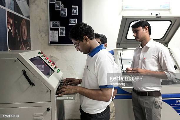 Students attend a computer numerical control operator class during vocational training at the Infrastructure Leasing Financial Services Institute of...