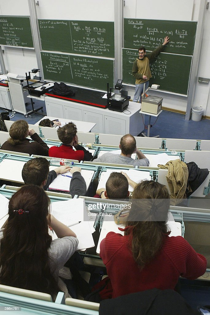 Students attend a lecture in the computer studies department at the Freie Universitaet January 13, 2003 in Berlin, Germany. The German university system is facing cuts of EUR 75 million in state funding over the next four years as the German government pushes through financial reforms. German politicians are also deliberating whether to start making students pay for at least a portion of the costs of their university education, though the proposal has met with fierce resitance from students, who went on strike across Germany last month.