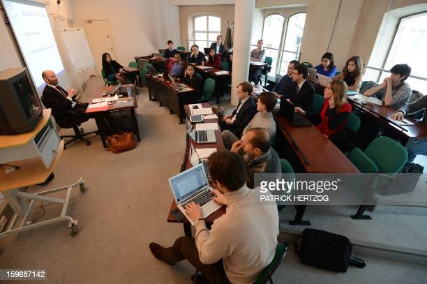SIMON Students attend a trading seminary with French teacher Aurelien Colson in a conference room at the Ecole Nationale d'Administration on January...