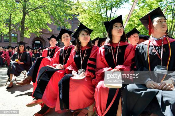 Students attend at the Harvard University 2018 367th Commencement exercises at Harvard University on May 24 2018 in Cambridge Massachusetts Receiving...