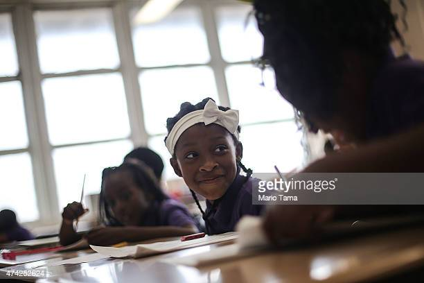 Students attend class at the Encore Academy charter school on May 13 2015 in New Orleans Louisiana More than 100 schools in the city were damaged or...