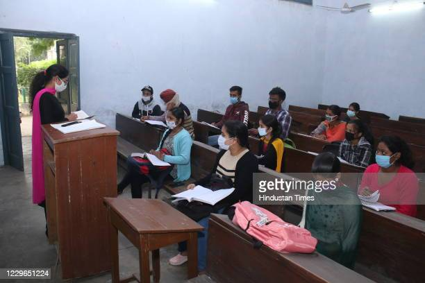 Students attend classes at Government Rajindra College after the state government decided to re-open universities and colleges that were closed due...