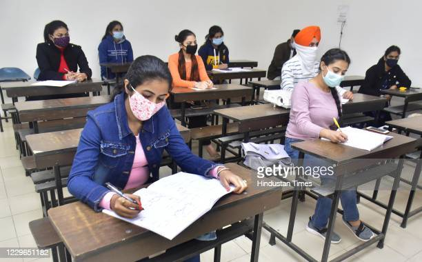 Students attend classes at Khalsa College after the state government allowed reopening of colleges and universities that were closed due to the...
