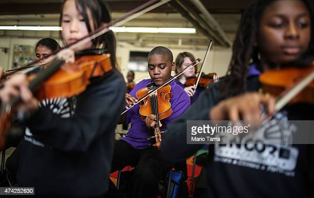 Students attend music class at the Encore Academy charter school on May 13 2015 in New Orleans Louisiana More than 100 schools in the city were...
