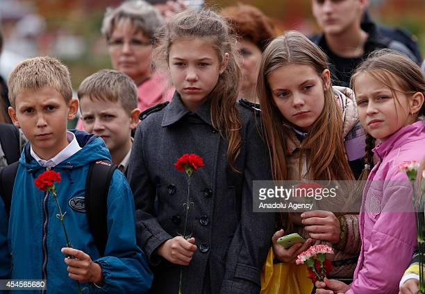 Students attend the commemoration ceremony of victims of Beslan school hostage crisis which ended with 334 people killed including 186 children and...