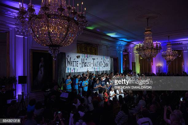Students attend the White House Turnaround Arts Talent Show at the White House May 25 2016 in Washington DC Students from throughout the US performed...