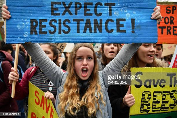 Students attend the YouthStrike4Climate demonstration against climate change in Parliament Square central London on April 12 2019