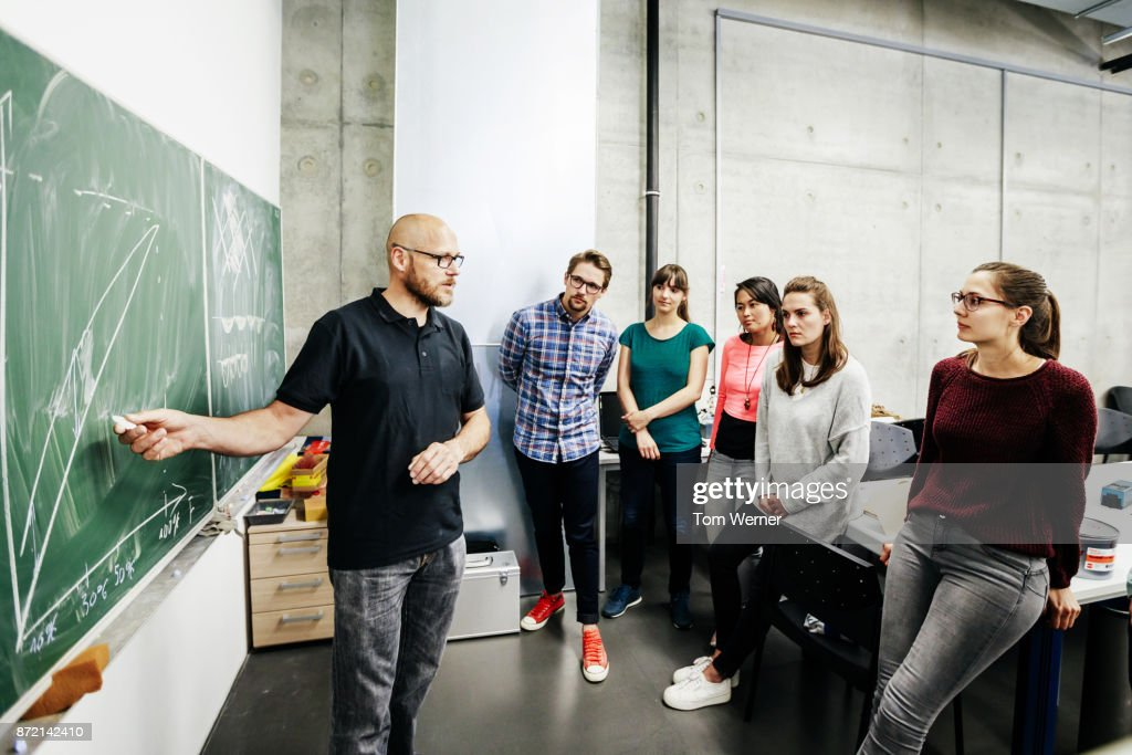 Students Attending Lab Work Seminar With Technician : Stock Photo