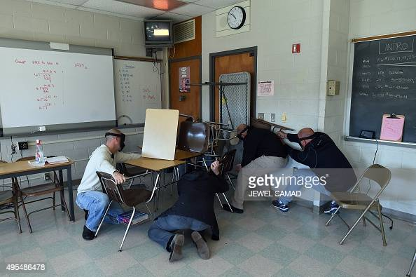 Students Barricade A Door Of A Classroom To Block An