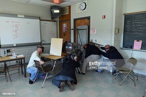 'Students' barricade a door of a classroom to block an 'active shooter' during ALICE training at the Harry S Truman High School in Levittown...