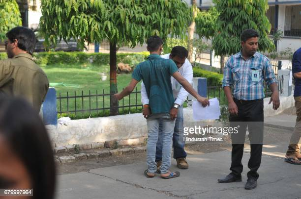 Students being checked and asked to remove their shoes and other accessories before the CBSE National EligibilityCumEntrance Test medical entrance...
