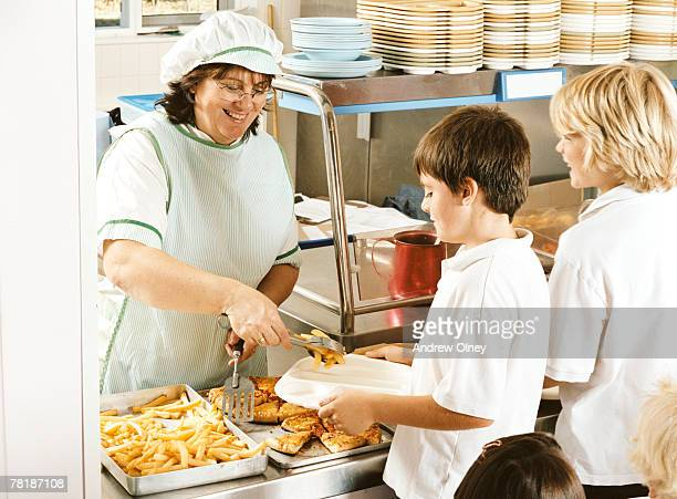 Students being served lunch in the cafeteria