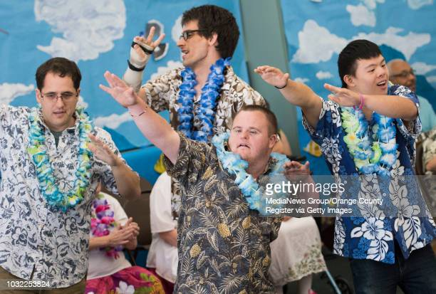 Students Ben Shiflett Michael Bertrand Nathan Bush and Mike Thai from left strike a pose during a Luauthemed performance at Creative Identity a...