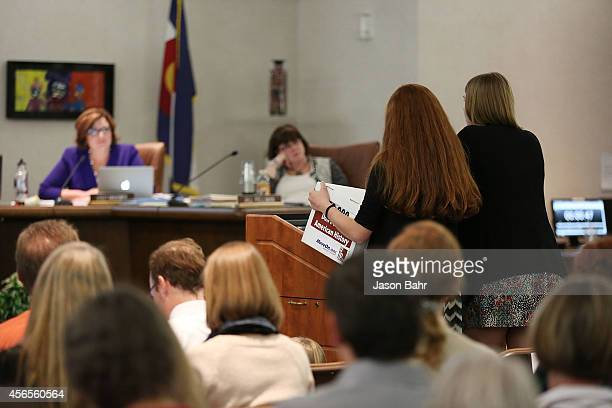 Students Bethany Keupp and Jocelyn Wallen present signed petitions to the JEFFCO Public Schools Board of Eduction as part of a protest on October 2,...