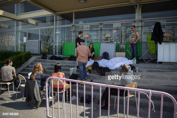 Students block access on the campus of the Nanterre University west of Paris on April 18 2018 during nationwide demonstrations of university students...