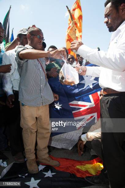 Students burn a copy of the policy in Port Moresby on August 2 during a protest rally against Australia and PNG's asylum seeker plan Australia's...